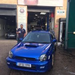 client neil with his subaru impreza wrx sti