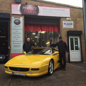 picture of client picking up his ferrari f355 gts after we fixed the engine